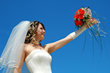 bride holding up red bouquet