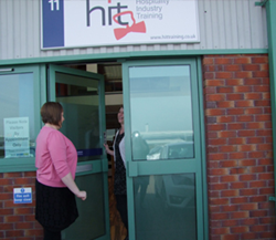 A customer is welcomed into Waterhouse Business Centre
