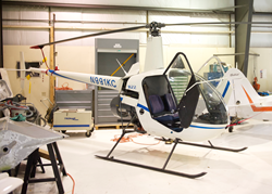 A helicopter stored in a hangar at Salt Lake Community College's International Aerospace/Aviation Education Center.