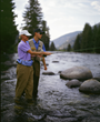 Fly fishing on the Gallatin River, a Blue Ribbon trout stream that runs through the 320 Guest Ranch