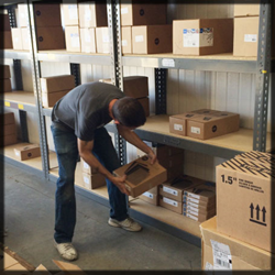 A Docucopies team member stocks binding supplies at the new facility.