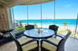 All oceanfront suites have a beautiful screened in porch - a wonderful place to watch sunsets over Grace Bay.