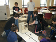 RIC children's robotics team with robot in action.