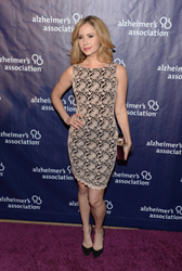 "Ashley Jones carries Jill Milan's Art Deco Clutch to the ""A Night At Sardi's"" gala supporting the Alzheimer's Association, March 26, 2014 at The Beverly Hilton Hotel. (Photo: Jason Kempin/Getty Images)"