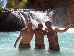 Residents swim in Havasu Falls after a ten mile hike to camp grounds.