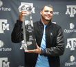 Mike Evans lifts the CFPA Trophy