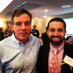 Mark Warner and Michael Rihani pose for a photo after Senator Warner's morning speech