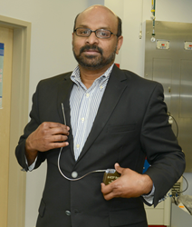 Dorn VA Director of Cardiac Arrhythmia Services Dr. Sony Jacob demonstrating the defibrillator device and the coil in position.