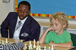 NSCF instructor Tharin Chadwick works with a student during summer chess camp in Hartsdale.