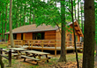 Photo Courtesy of the West Virginia Department of Commerce.   Many cabins like this one at North Bend State Park are available for mid-week discounts this spring at West Virginia State Parks and Fores
