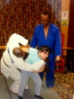 Blind Student Being Introduced to Judo Demonstrating Her First Throw - Coach Merriweather in Blue Judogi; Chris Jones in White Judogi