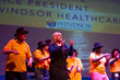 "Batsheva Katz, VP of Windsor Healthcare, and the Windsor Healthcare choir of elders from nine New Jersey nursing homes sing ""Happy"" and dance at NJ Performing Arts Center.  (Matt Rainey)"