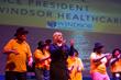 "Batsheva Katz, VP of Windsor Healthcare, and the Windsor Healthcare choir of elders from nine New Jersey nursing homes sing ""Happy"" and dance at NJ Performing Arts Center.  (Matt Rainey)"