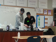 Students Jacob Phipps and Domingo Tamayo conduct chemistry experiments at schools on the Pine Ridge and Rosebud Indian reservations to empower Native American youth to pursue higher education.