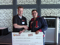 Sander Van Ingen (left) from Rohit Communities with winner Stephen Ewaskiw.