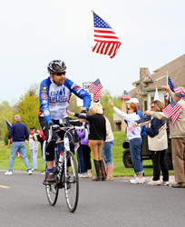 Fidelity & Guaranty Life Senior Vice President Paul Tyler bicycles during the 2013 Face of America.