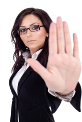 Image credit: <a href='http://www.123rf.com/photo_9971973_serious-business-woman-making-stop-sign-over-white.html'>feedough / 123RF Stock Photo</a>