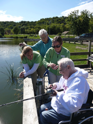 Hospice volunteers take a patient on a fishing excursion.