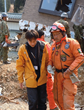 The head of Los Topos (right) and the head of the Japanese Volunteer Ministers team (left), helping with the search and rescue after the March 2011 tsunami.