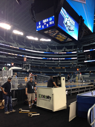 101 Mobility Dallas installing a commercial wheelchair platform lift at AT&T Stadium  for the Final Four.