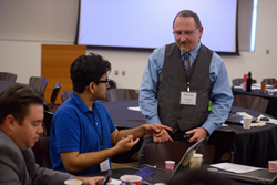 ASU PhD student and Energy Club Leader Jason O'Leary speaks with a colleague at the Arizona Student Energy Conference.