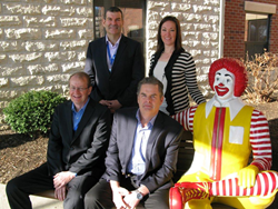 Clockwise: Steve Grossrieder, COO; Megan Koester, RMH Charities; Stuart Davies, CEO; John Tutt, EVP Club Assist North America