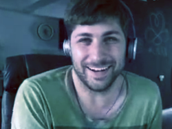 Computer screen capture of young man wearing headphones
