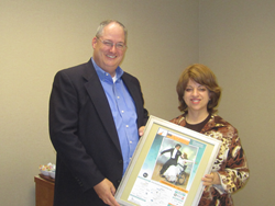 Rachel Davis, the Chief Development Officer at Jewish Family Services of Houston presented Monte Osburn, executive director of the Mostyn Moreno Foundation.