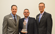 Frankenmuth Insurance Chairman & CEO John S. Benson (left) and President and COO Fred Edmond (right) present the company's 2013 Agency of the Year award to HBL Insurance Principal Mark Hatz.