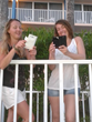 Katie and Jen on the beach using RF Safe flips cases for safer cell phones