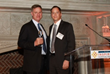 Rep. Scott Peters (left) receives the 2014 Visionary Award from CHI President and CEO Todd Gillenwater (right).