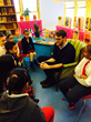 Luke Kelly reads to students at P.S. 8 Luis Belliard in New York City