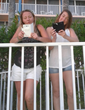 Katie and Jen using RF Safe cell phone radiation shielded flip cases while on holiday in North Redington Beach
