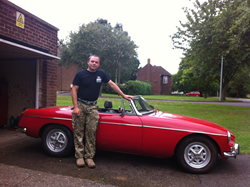 Sergeant Jason Sheehan with his 1970 MG Roadster