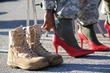 "Men unlace their shoes and don stilettos to ""Walk a Mile"" in women's shoes and draw attention to the need to stop rape, sexual assalt, and gender violence"