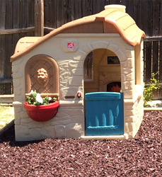 Everlast Rubber Mulch around a playhouse.