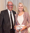 Designer Jean Verbridge receiving her Clarke Kitchen Design Award from Clarke CEO Tom Clarke.