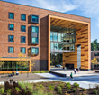 ADD Inc created a building with a large arch that leads from a wooden overlook of the Tekoa Mountains back to the campus quad.