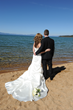Bride and groom can use The Landing's private beach access Lake Tahoe photo ops. © The Landing Resort & Spa