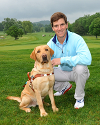 NY Giants Quarterback and eight-time Guiding Eyes for the Blind Golf Classic host Eli Manning with Guiding Eyes dog Taft.
