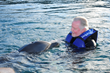 Actor Jon Voight seemed to talk with the dolphins while they approached him and let themselves be caressed.