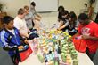 Students from Arkadelphia Public Schools in Arkansas sort donated food items from the SIMPLE Giving program into backpacks, which will be sent home with needy students in their district for weekend us