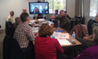 Denise Drane, Northwestern University, provides feedback using video conferencing to teachers as they describe testing lessons that incorporate applied critical thinking, during ACTivATE training spon