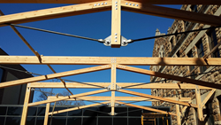 Overhead trusses and tubular steel X-bracing which will be visible to the interior