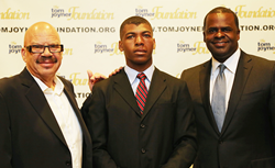 Titus Zeigler (center) with Foundation Chairman Tom Joyner (left) and Atlanta Mayor Kasim Reed (right)