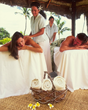 Four Seasons Resort Maui guests can luxuriate with couples massages in one of the Resort's oceanside authentic Hawaiian hales