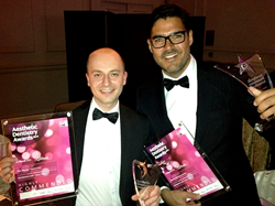 Dr Brunner and Petr Mysicka collecting Aesthetic Dentistry Award.