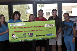 American Dental Association Give Kids a Smile donation from SmartPractice 2014 SmartScramble Golf Tournament