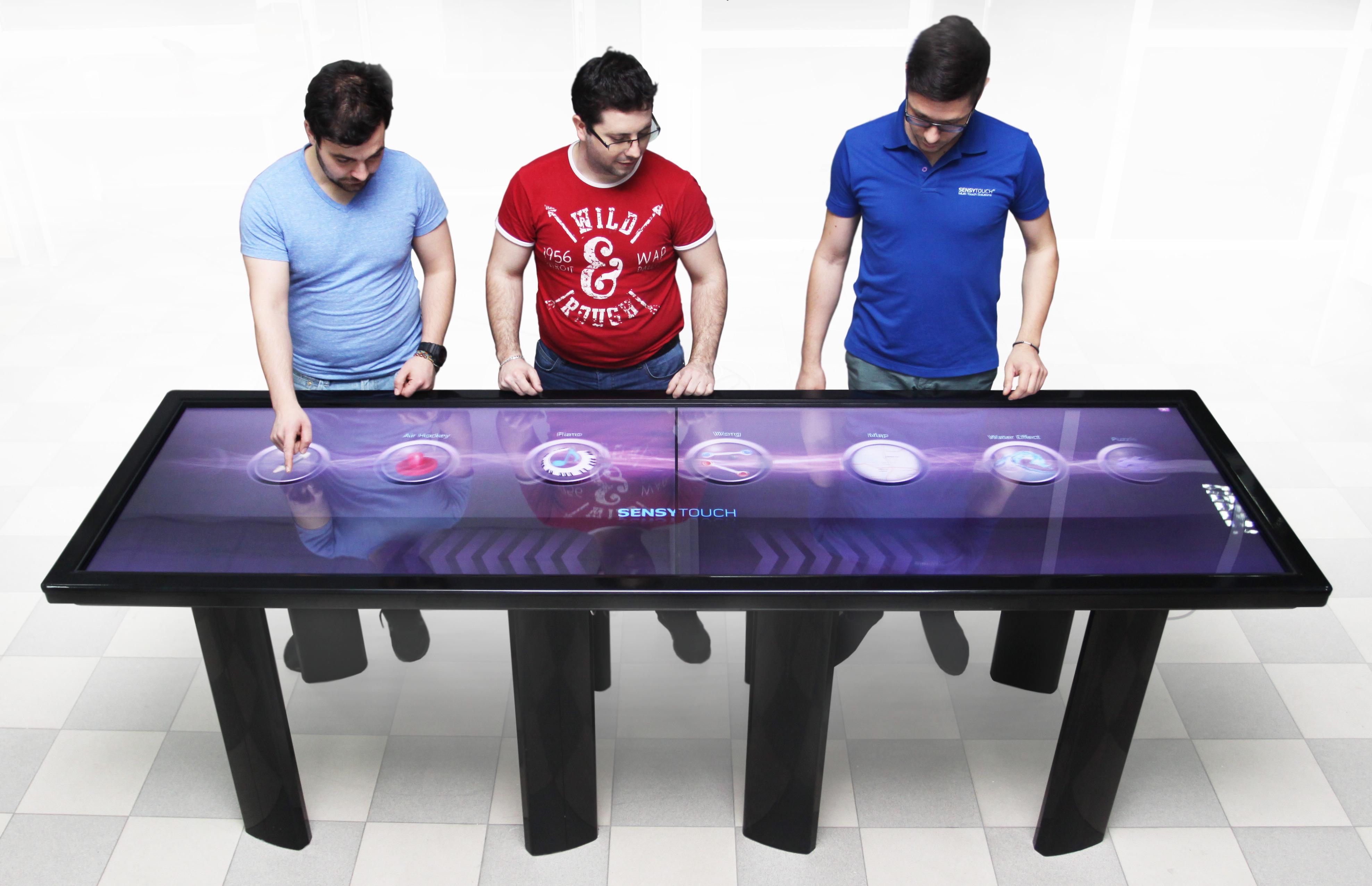 Sensytouch creates world s sleekest 100 inch multi touch table for Tisch interaction design