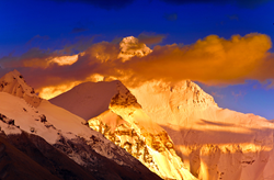Mt. Everest looks like a huge pile of gold in the sunrise.